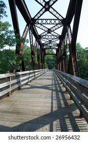 A rusty old steel bridge