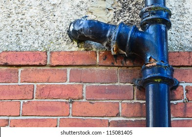 Rusty old toilet waste pipe in need of replacement