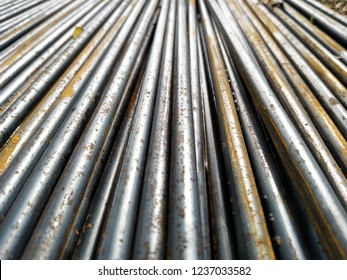 Rusty on surface of rods bar ( round bar steel ) , can used for construction material abstract background.