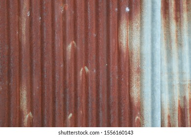 Rusty on zinc. Bad quality zinc roof. Rusty texture background.