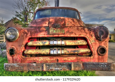 Rusty Pick Up Truck in a Junk Yard display. HDR