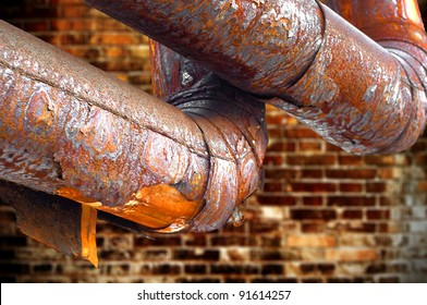 Rusty pipes, through many years.