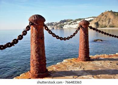 Rusty railings on boardwalk,