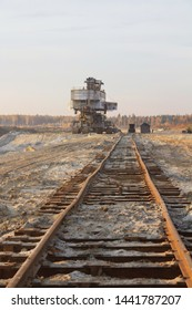 Rusty railroad tie. Giant stacker. Bucket chain excavator in a sand quarry. Bulk material handling