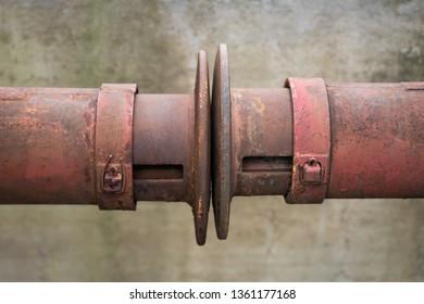 Rusty railway wagon buffers on old train