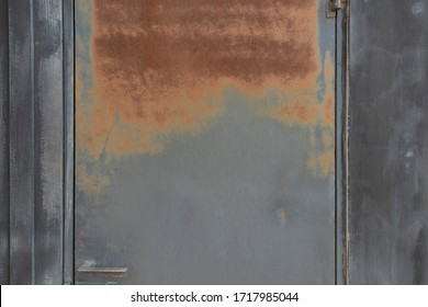 Rusty red on black iron door. Side of the door is black wood, the surface and black background, the surface of rust. design work concept.