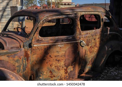 Rusty, relic, of a grand old car, used in the 1930's until World War Two. Vintage derelict car, abandoned to the elements, well over ninety years old.