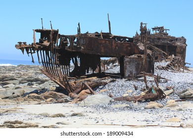 Rusty remains of a shipwrecked boat on the Skeleton coast, Namaqualand, Northern Cape, South Africa
