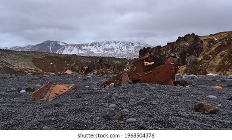Rusty remains of the wreckage of Grimsby fishing trawler Epine (GY7) at Djúpalónssandur beach on west coast of Snæfellsnes peninsula, Iceland with black colored pebble stones and lava rocks.