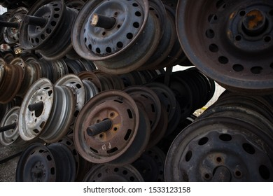 Rusty rims, awaiting recycle or resale. At a car cemetery. Kozani, Greece.