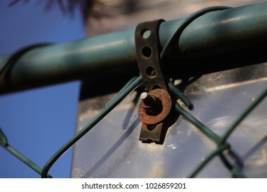 rusty screw on wired fence