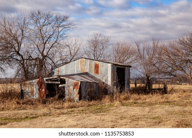 Rusty Shed Against Clouds