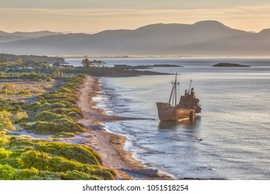 Rusty Shipwreck dimitrios in early morning light on Peloponnese coast of Greece