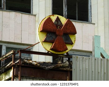 rusty sign of radioactivity on a building in abandoned city of Pripyat, town destroyed by nuclear catastrophe in nearby Chernobyl power plant, located in Chernobyl Exclusion Zone, Ukraine, East Europe