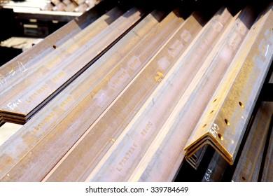 Rusty steel member bunch in warehouse