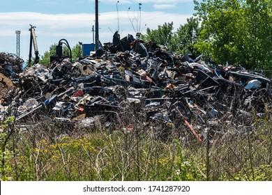 Rusty steel sheet at a junkyard. Pressed metal junk on the junkyardmetal,steel,aluminum,iron...
