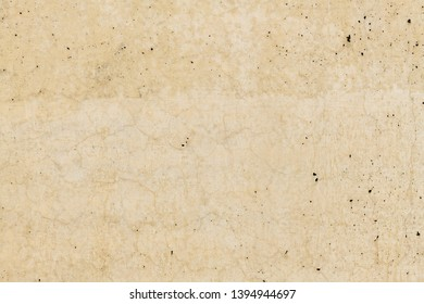 Rusty stone concrete surface in tan color, detailed natural texture.