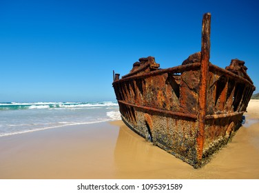 Rusty stranded, sunken 'Maheno' vessel at Fraser island beach. Queensland, Australia.