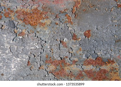 rusty surface of an old bridge pier