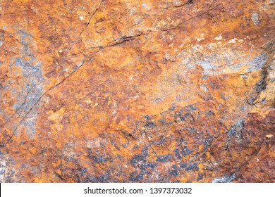 Rusty texture. Stone rusty background. Colorful granite stone background. Old Cracked Rusty Rough texture. Rock wall backdrop with rough red brown texture. Grunge Abstract Stone Surface.