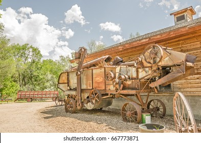 Rusty threshing machine looks unwieldy and very difficult to use