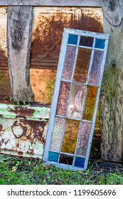 rusty tin and stained glass window, architectural details at salvage yard