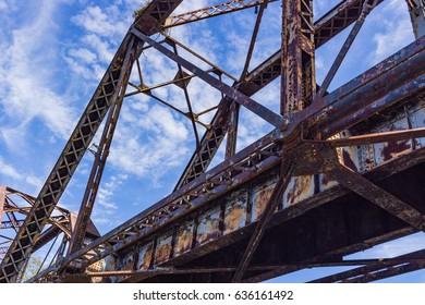 Rusty Train Bridge Over River