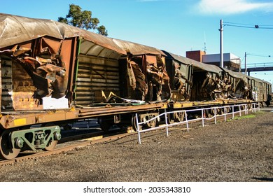 Rusty train carriage wreckage after a train crash