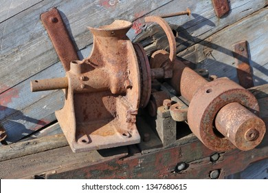 Rusty  vintage  small  agricultural machine parts. The metal equipment is made more than hundred years ago. Mass production.