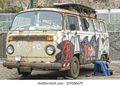 Rusty Volkswagen van wreck  in Lima Peru, used as a surfboard equipment storage.