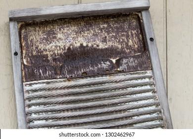 Rusty Washboard. Old antique washboard on a wall.