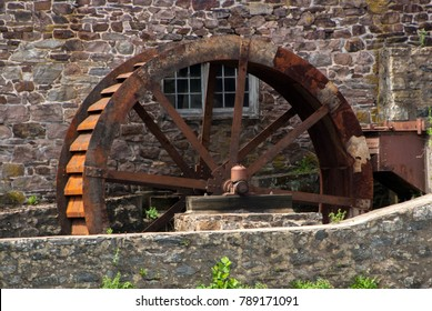Rusty Water Wheel at a Mill