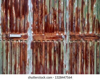 Rusty weathered iron door.
