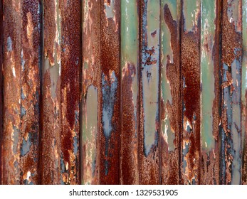 Rusty weathered iron door closeup.