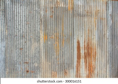 A rusty and weathered looking piece of corrugated metal.