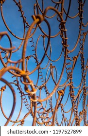 Rusty wire in front of blue sky