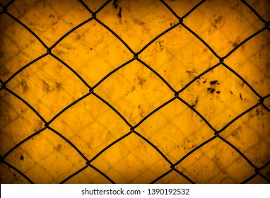 Rusty Wire Netting on the Old Metal Background