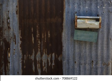 rusty zinc and mail box on a house door