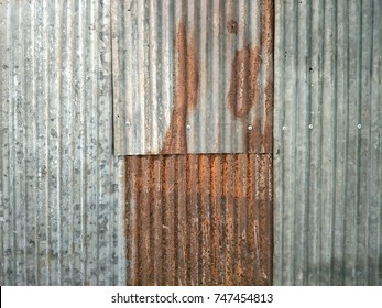 Rusty zinc wall for abstract texture background