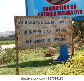 RUSUMO, RWANDA - SEPTEMBER 19, 2012. The welcome to Rwanda sign at the border crossing into Rwanda from Tanzania at Rusumo.