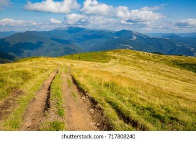 rut road on mountains slope. Ukraine, Carpathians