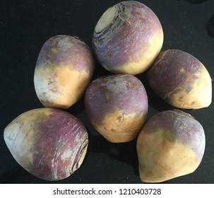 Rutabaga vegetable on black table
