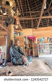 Ruteng Puu traditional village, Flores, Indonesia - August 2018: Unknown old shaman, a local tribe head in wooden house.  The people of Indonesia