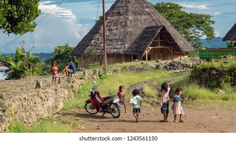 Ruteng Puu traditional village, Flores, Indonesia - August 2018: A modern-times small community of tribesman. Kids playing outdoors. The children of Asia