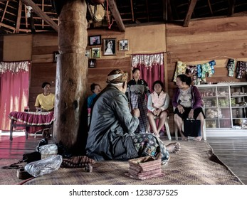 Ruteng Puu tradtional village, Flores, Indonesia - August 2018: A village head talking to his family. He is the community leader of their tribe