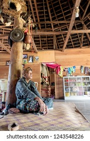 Ruteng Puu tradtional village, Flores, Indonesia - August 2018: A village headman in his traditional, round, wooden house. He is the community leader of the whole tribe. The people of Indonesia