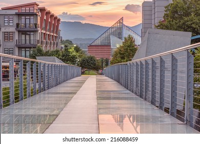 The Ruth S. and A. William Holmberg Pedestrian Bridge in Chattanooga has a backlit glass floor and is popular with residents and tourists. Focus stacked HDR. Tennessee aquarium in background.