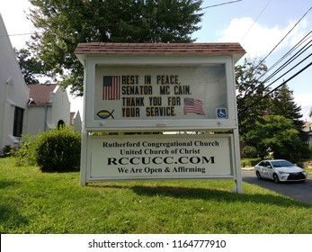 """Rutherford, New Jersey / USA - August 26 2018: The sign on the lawn of the Congregational Church remembers the life of Senator John McCain: """"Rest In Peace Senator McCain. Thank You For Your Service."""""""