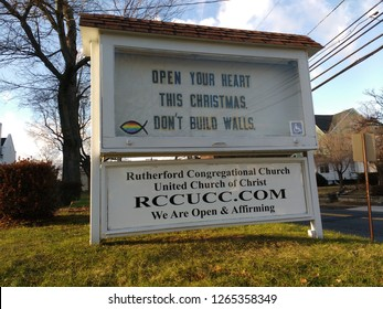 """Rutherford, New Jersey / USA - December 22 2018: Responding to the US government shutdown over Trump's border wall, the Congregational Church says, """"Open Your Heart This Christmas. Don't Build Walls."""""""