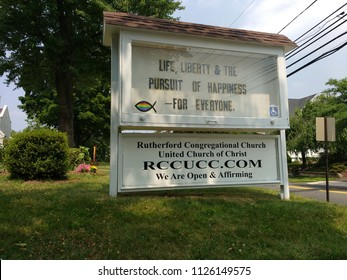 Rutherford, New Jersey / USA - July 03 2018: The sign on the lawn of the Congregational Church celebrates the US Declaration of Independence: Life, Liberty & The Pursuit Of Happiness - For Everyone.